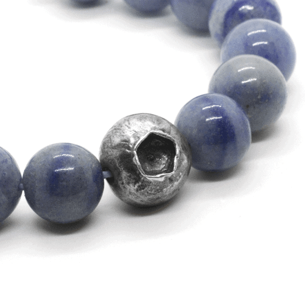 A Yemanja bracelet with a centre piece in 925 silver and the rest of the necklace made of small blue quartz beads.