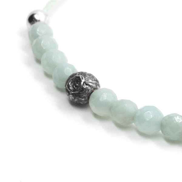 An Oxossi bracelet, with a 925 silver centrepiece and the rest of the necklace made of small amazonite beads.