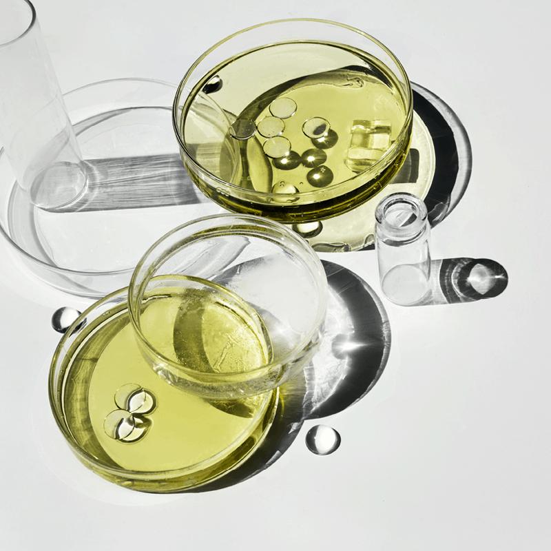 Laboratory dishes containing yellow liquid.