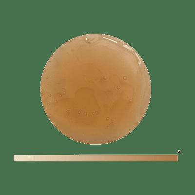 Die Textur des Balance Serums von Yemanja, mit einer braunen Farbe.